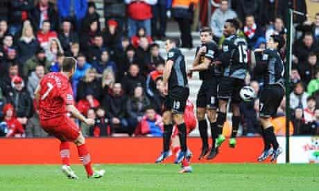 Southampton's Rickie Lambert, left, scores against Liverpool in the Premier League