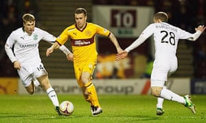 Motherwell's Nicky Law, centre, scored two second half goals against Hibernian in the SPL