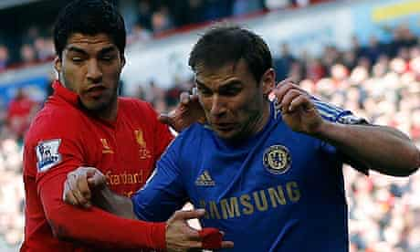 Luis Suárez, left, and Branislav Ivanovic tussel during Liverpool's 2-2 draw with Chelsea at Anfield