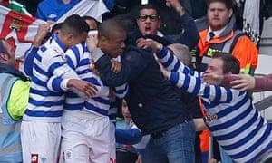 Loïc Rémy is hugged by QPR fans