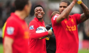 Daniel Sturridge, centre, with the matchball following his hat-trick for Liverpool against Fulham