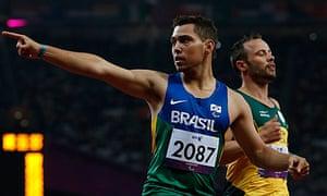 Brazil's Alan Oliveira celebrates in front of Oscar Pistorius