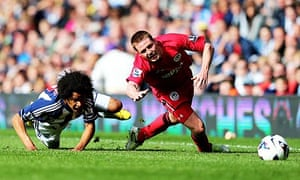 West Bromwich Albion's Isaiah Brown and Wigan's Shaun Maloney