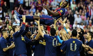 20282af43ae Barcelona players throw their team-mate Eric Abidal into the air after he  played his last match for the La Liga champions. Photograph  David  Ramos Getty ...
