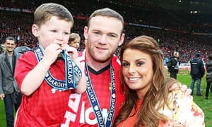 Wayne Rooney, pictured with son Kai and wife Coleen