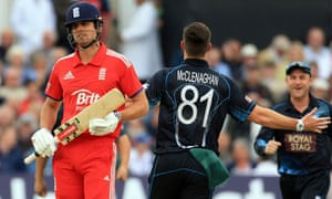 Mitchell McClenaghan of New Zealand celebrates trappng Alastair Cook