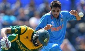 South Africa's Hashim Amla passes India's Bhuvneshwar Kumar
