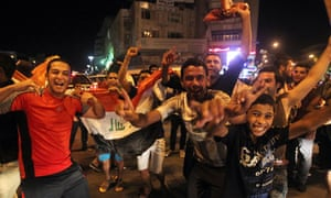 Iraqis celebrate in the streets of Baghd