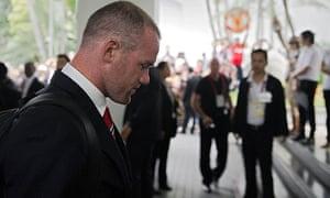 Wayne Rooney arrives at Manchester United's hotel in Bangkok. He left injured shortly after.