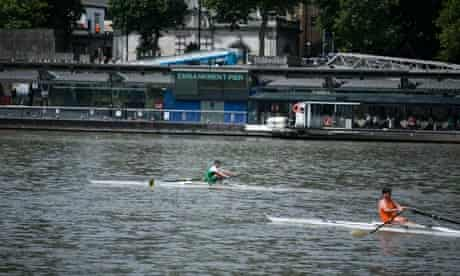 Rowers race on the Thames as they strive to win the 299th running of Doggett's Coat and Badge.