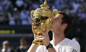 Andy Murray kisses the Wimbledon trophy