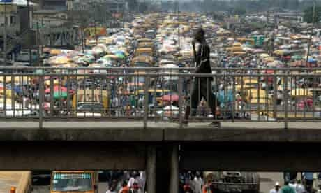 Man walks on pedestrian bridge in Lagos, Nigeria