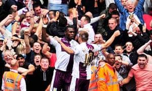 Aston Villa's Christian Benteke, left, celebrates his second goal against Arsenal