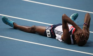 Mo Farah celebrates after winning the 5,000m final at the world championships in Moscow.