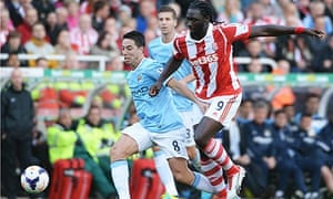 Stoke City's Kenwyne Jones and Samir Nasri of Manchester City in the Premier League