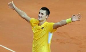 Bernard Tomic celebrates