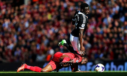 Liverpool's Victor Moses and Southampton's Victor Wanyama, right, in the Premier League at Anfield