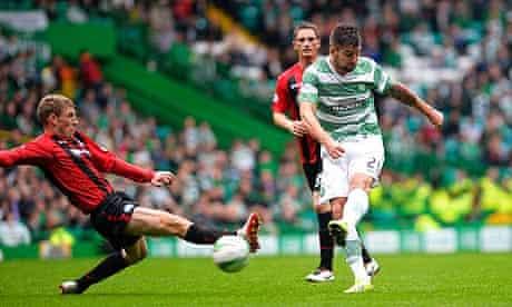 Celtic's Charlie Mulgrew, right, scores against St Johnstone in the Scottish Premiership