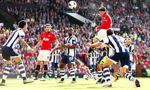 Manchester United's Wayne Rooney heads at goal against West Bromwich Albion in the Premier League