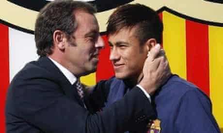 Sandro Rosell embraces Neymar upon the Brazilian's arrival at Barcelona last June