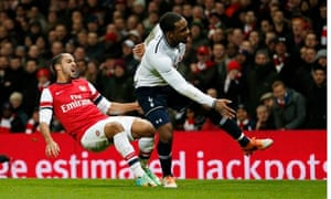 Pain is etched on Theo Walcott's face as he goes down injured after a challenge with Danny Rose.