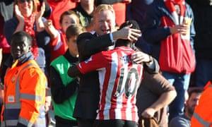 Southampton's manager, Ronald Koeman, embraces Sadio Mané after the striker scored against Stoke.