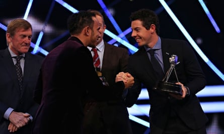 Rory McIlroy, right, shakes hands with Lewis Hamilton