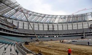 Men working inside the National Stadium in Baku.