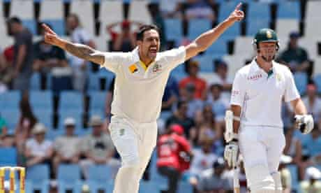 Australia's Mitchell Johnson celebrates as he takes the wicket of Alviro Petersen