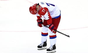 Russia's Anton Belov reacts to his team's 3-1 defeat to Finland in the men's hockey event