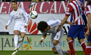 Real Madrid's Cristiano Ronaldo fires in a free-kick against Atlético.