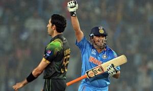 Suresh Raina celebrates India's win over Pakistan as Umar Gul turn away in despair