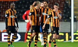 Hull's players celebrate the goal that took them into the FA Cup sixth round at Brighton's expense.