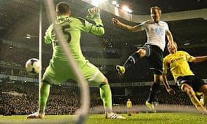 Harry Kane prods the ball past the Sunderland keeper Vito Mannone for Tottenham's second goal.