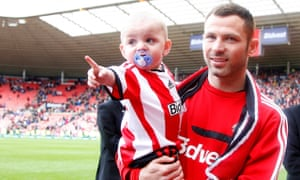 Phil Bardsley walks around the pitch in his last appearance as a Sunderland player