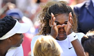 Serena Williams wipes her face