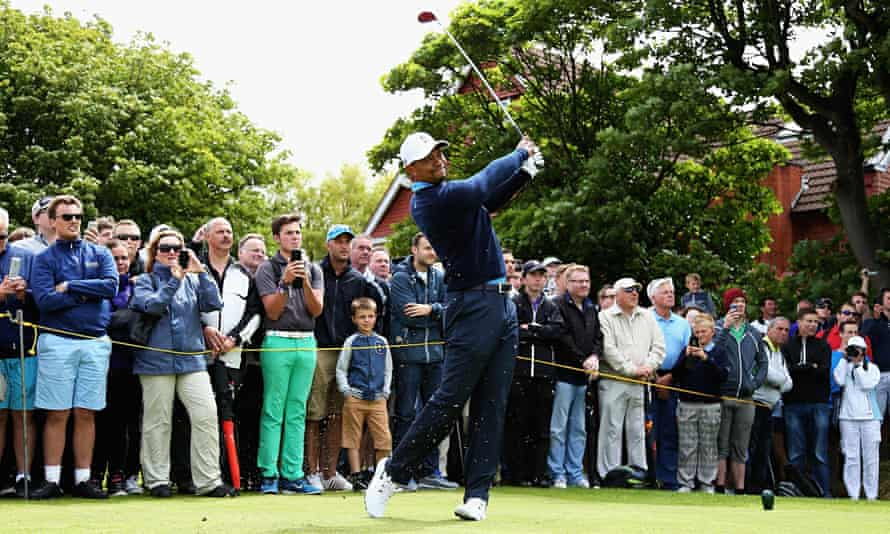 Tiger Woods tees off