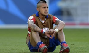 Chile's midfielder Arturo Vidal reacts a