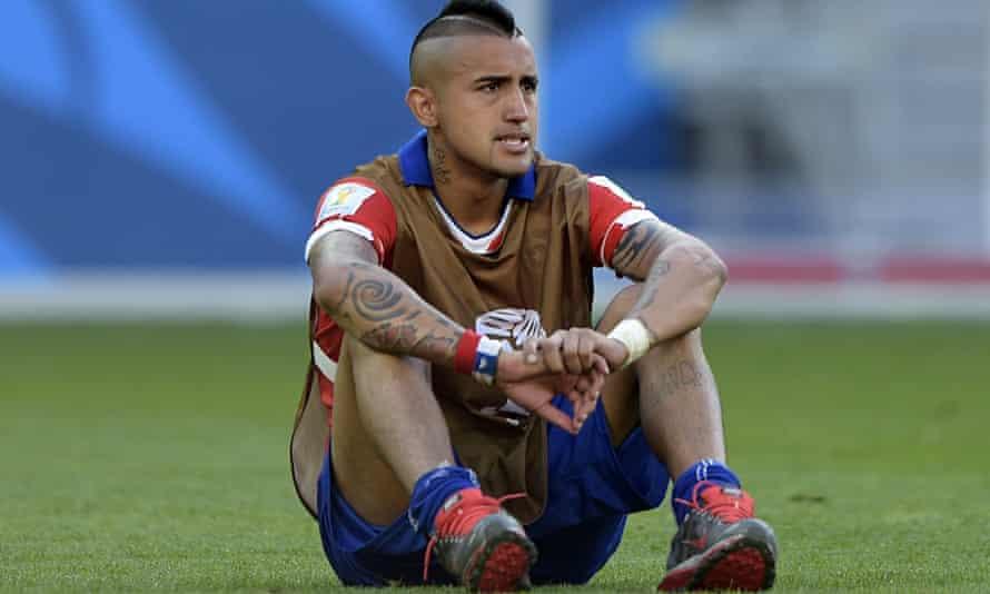 Chile's midfielder Arturo Vidal reacts a