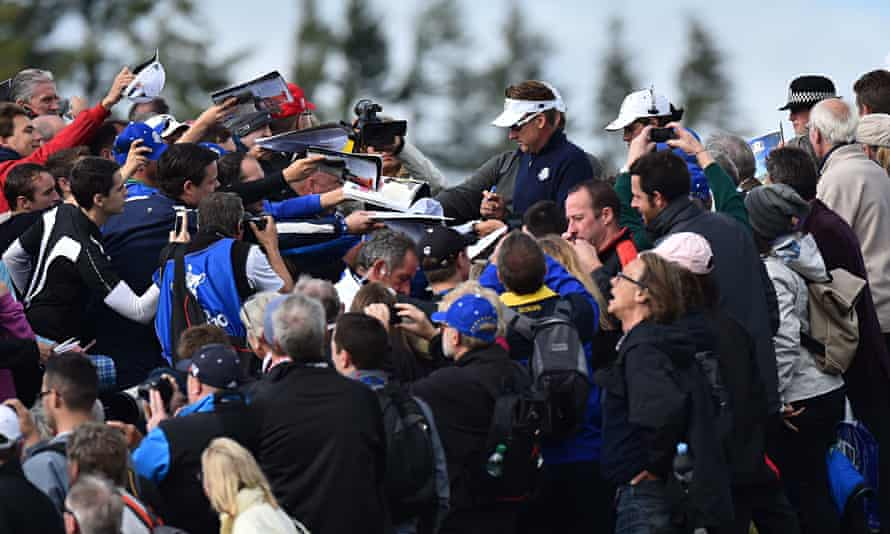 Ian Poulter signs autographs at the Ryder Cup