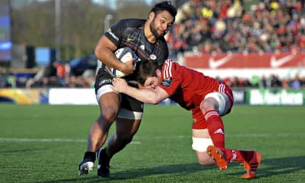A Munster tackler tries to halt the charge of Saracens' Billy Vunipola.