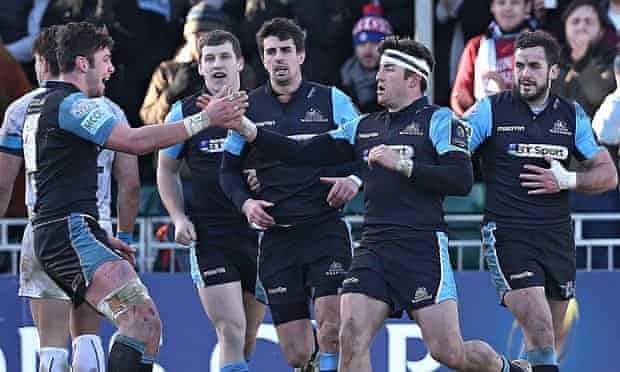 Wing DTH van der Merwe, in headband, celebrates his second try with his Glasgow team-mates.