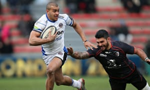 Yann David of Toulouse, right, struggles to lay a hand on the elusive Bath centre Jonathan Joseph.