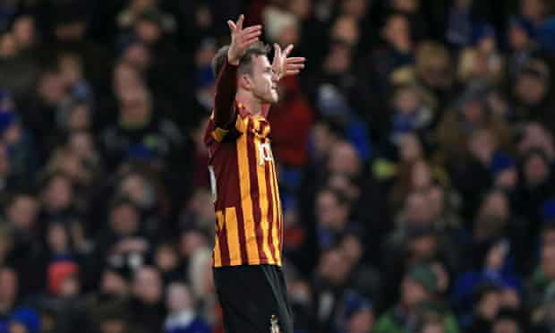 Andy Halliday celebrates scoring Bradford's third goal against Chelsea at Stamford Bridge.