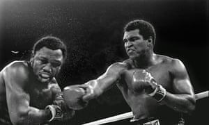 Muhammad Ali, right, stuns Joe Frazier in the ninth round of theirfight in Manila on 1 October 1975
