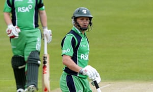 Ireland's cricketer Brett Lee (R) celebr