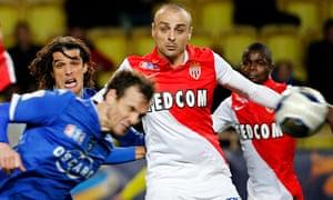 Monaco's Dimitar Berbatov challenges Bastia's Sebastien Squillaci