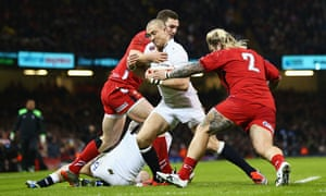 Mike Brown of England is tackled by George North and Richard Hibbard of Wales