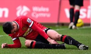 Robin Van Persie lies injured during Manchester United's 2-1 defeat at Swansea last month