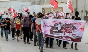 Protestors march against the presence of Formula One in Bahrain before the Bahrain Grand Prix.